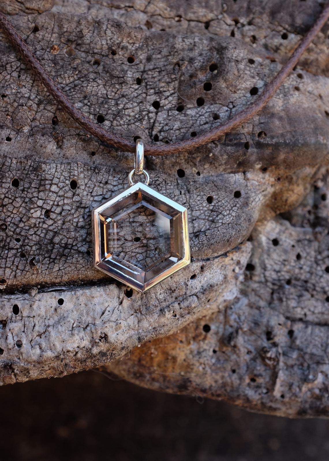 Hexagonal quartz and silver pendant