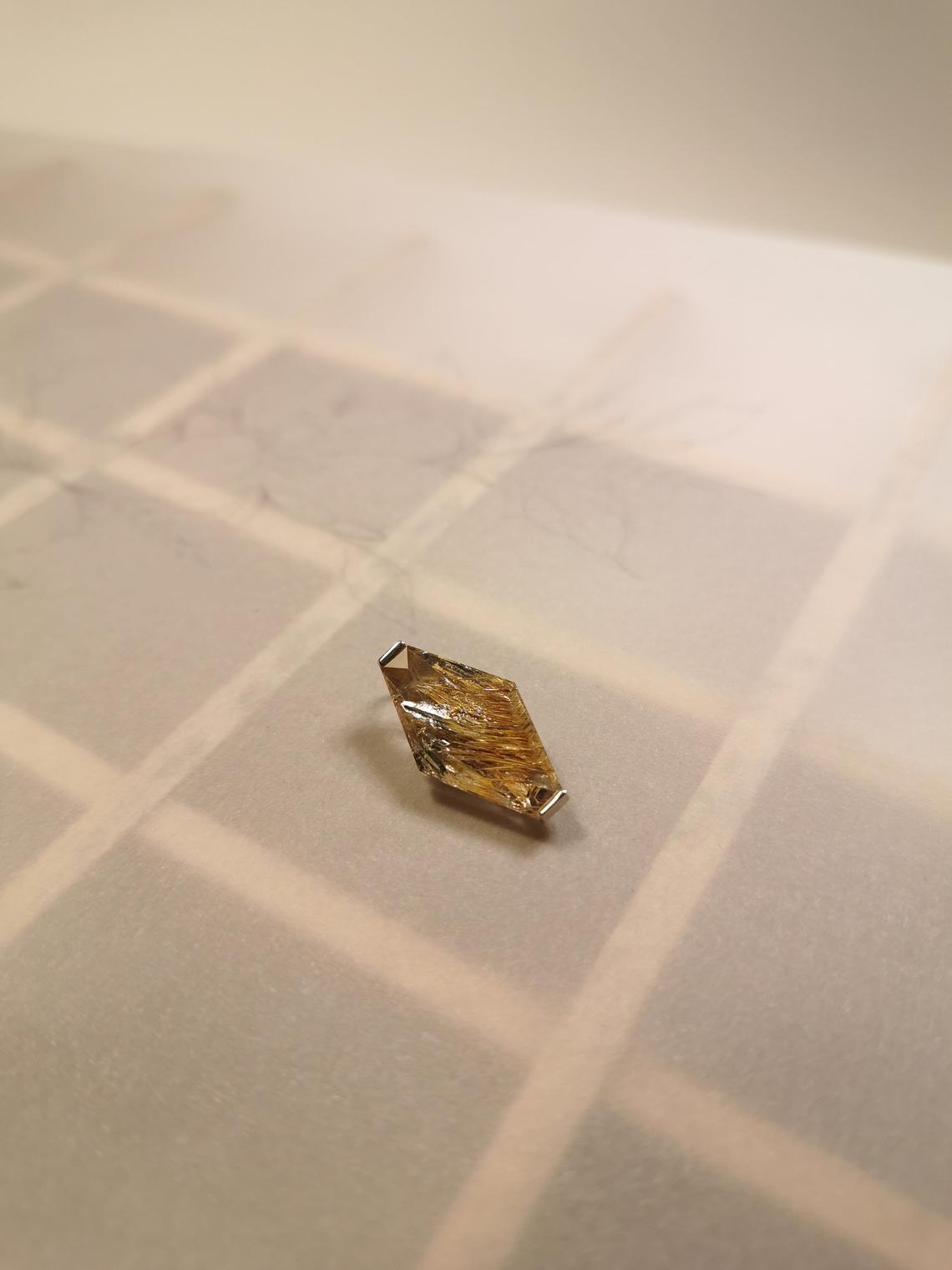 Quartz and Meneghinite pendant